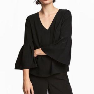 H&M divided black trumpet sleeve blouse